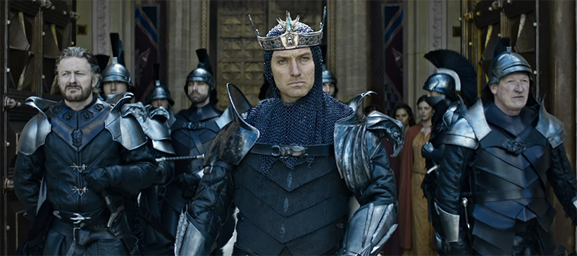 Jude Law revels at being the big bad. King Arthur Legend of the Sword. Image Credit: Warner Bros.
