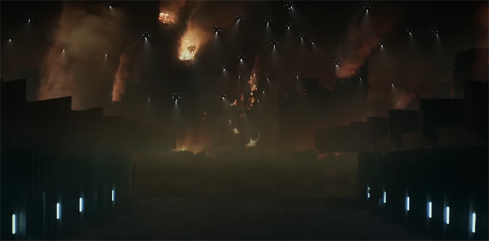 explosions rip through the city scape in the background as the enemy comes to them.