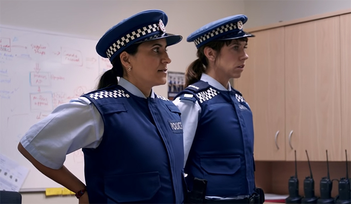 Mel and Jen just got caught in their fake police uniforms by the real police, awks.