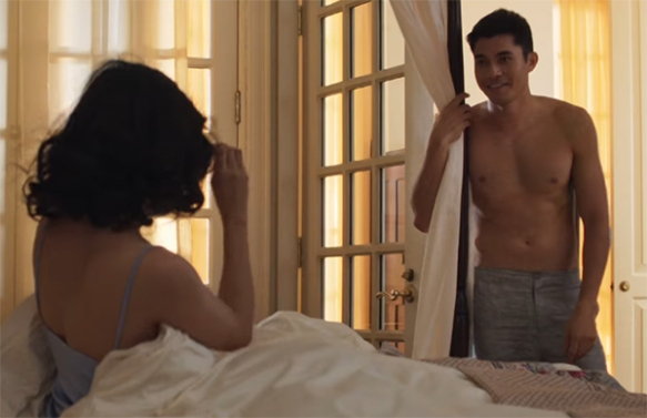 A shirtless Henry Golding