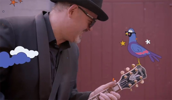 A man with a guitar talks to an animated pigeon, like trust me it makes sense.